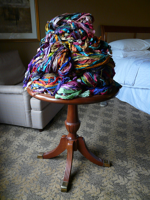 More skeins of sari silk ribbon artfully piled on a table