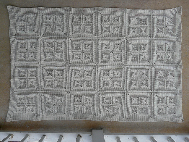 The front of the completed vanilla textured crochet squares afghan