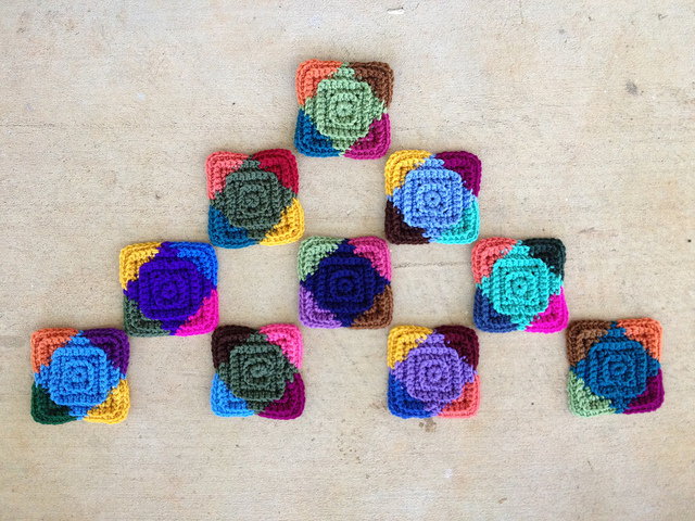 ten multicolor crochet square motifs