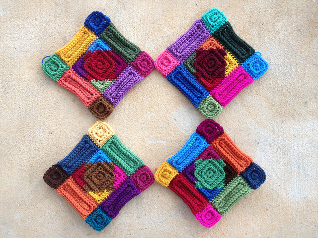 The four center crochet squares transformed into four more multi-color motifs