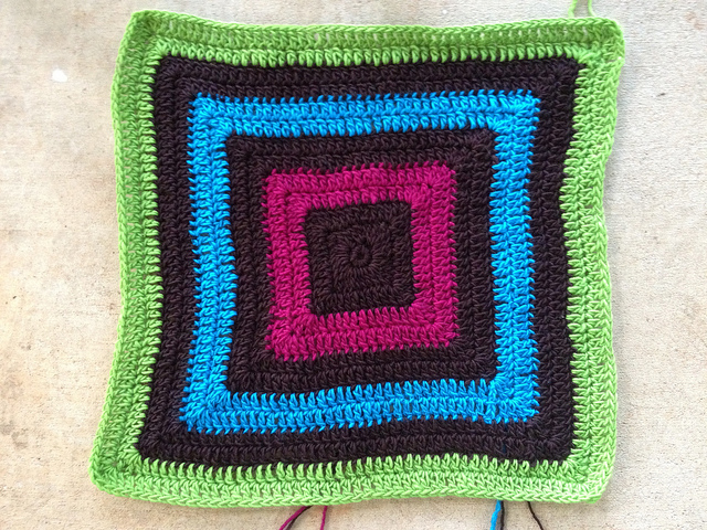 a crochet granny square for a future felted fat bag