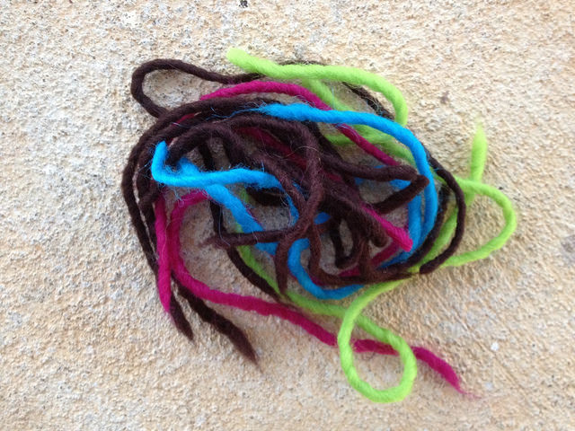 crochetbug, crochet yarn scraps, wool yarn, felted crochet, tootsie pop colors