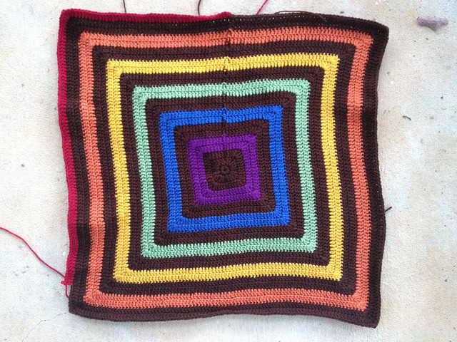 I work on the penultimate round of a large granny square