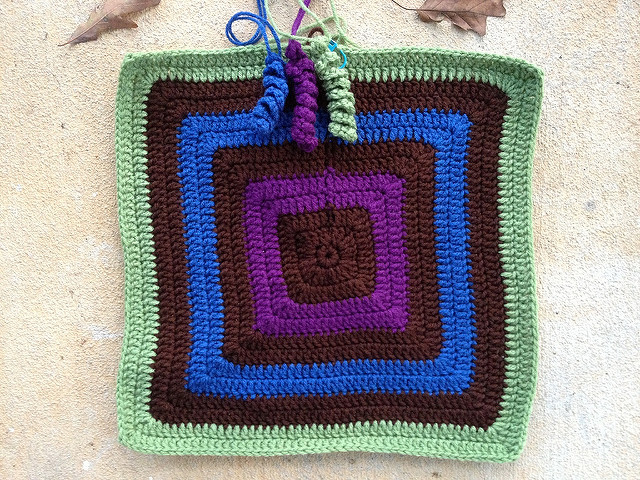 The future granny square fat bag with crochet curlicues for a tassel closure