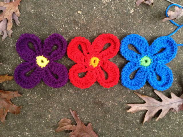 three large Hawaiian crochet flowers