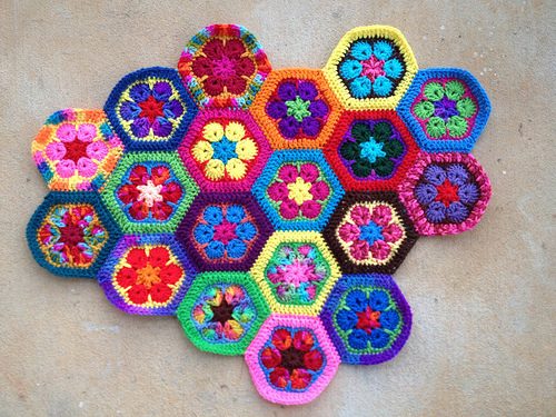 Nineteen African flower crochet hexagons joined with a whipstitch