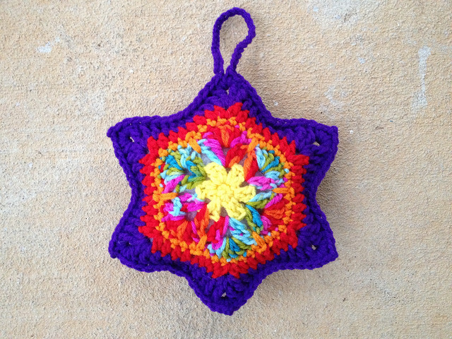 Front view of the African flower amigurumi crochet star for November 15
