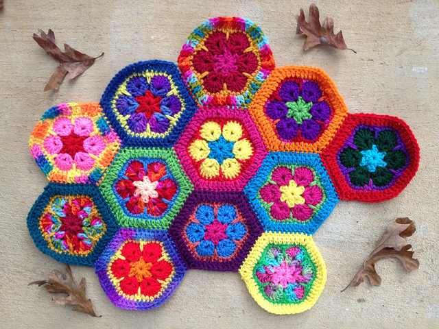 Twelve African flower crochet hexagons joined at the seams