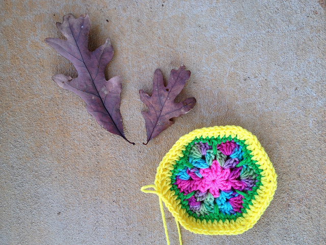 African flower crochet hexagon with a yellow border