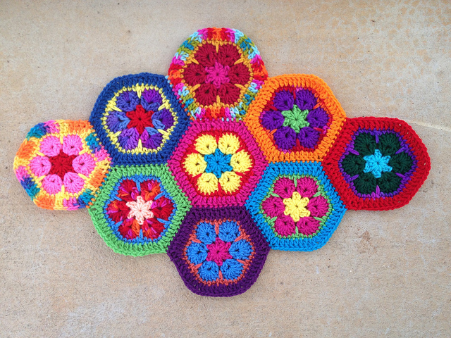 Nine African flower crochet hexagons joined with a whipstitch