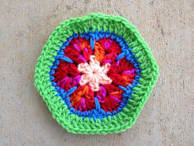 African flower crochet hexagon with a green border