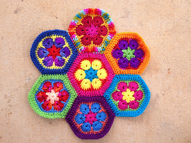 Seven African flower crochet hexagons joined with a whipstitch