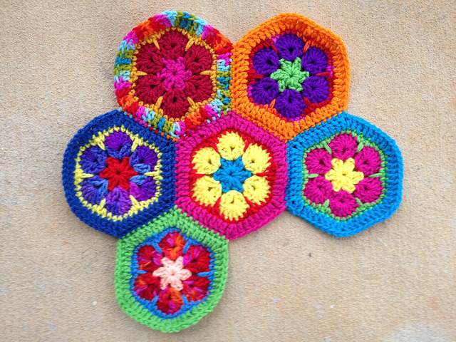 six multicolor crochet african flower hexagons