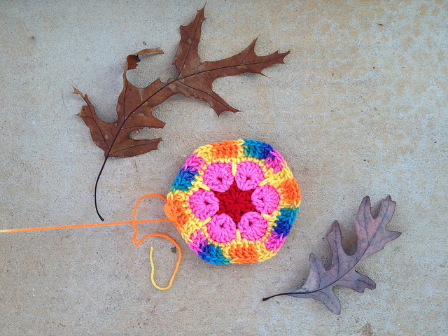 An African flower crochet hexagon with a variegated border