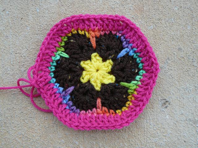An African flower crochet hexagon with a pink border
