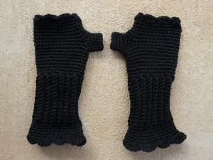 black fingerless crochet gloves made from vintage yarn
