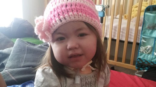 Adalynn Willett ready to go home in her awesome pink crochet hat