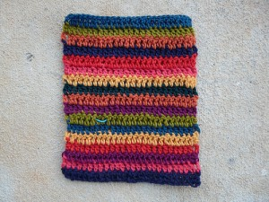 A swatch of double crochet stripes with the ends woven in and trimmed