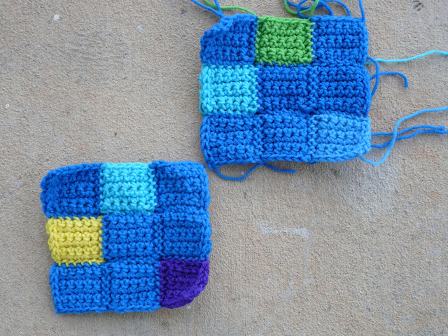 The last two nine-patch crochet squares needed to complete a crochet puzzle afghan