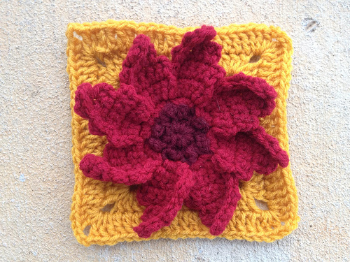 A granny square with a poinsettia center