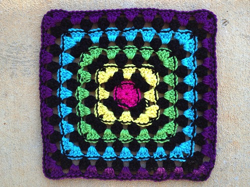 The back of a granny square with a border of slip stitches on every other round