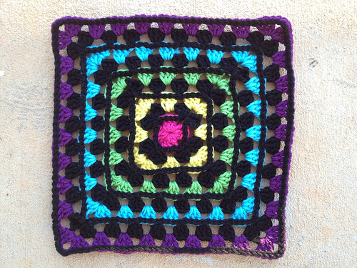 A granny square with a slip stitch bordering every other round