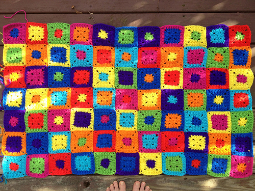 The first eleven rows of granny square throw for the back of a sofa