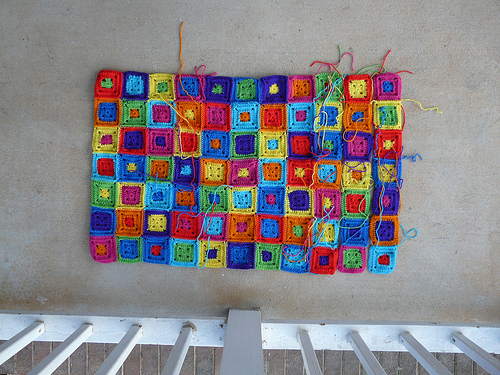 a future granny square sofa throw with ends to be woven in