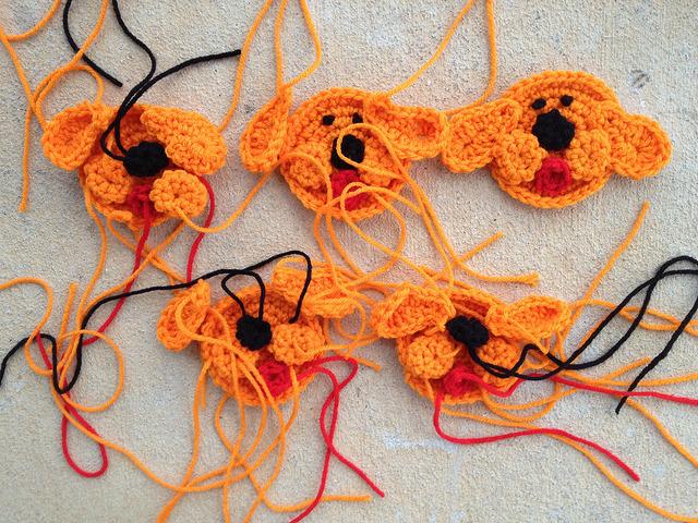 five crochet dog face hexagons