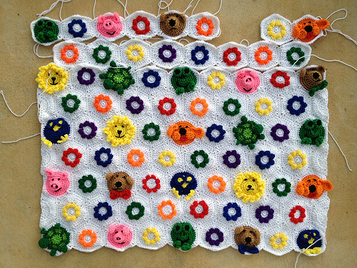 More than eight rows of crochet hexagons, but not quite nine rows