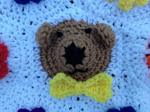 a crochet bear hexagon with a crochet bow
