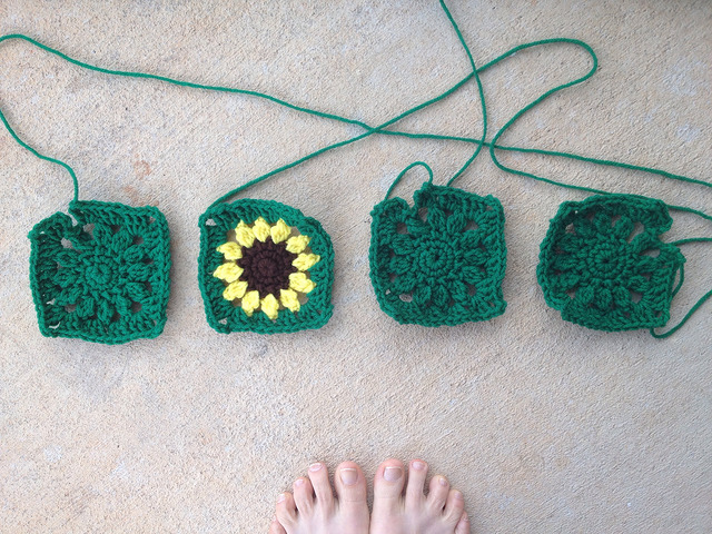 four sunflower crochet squares