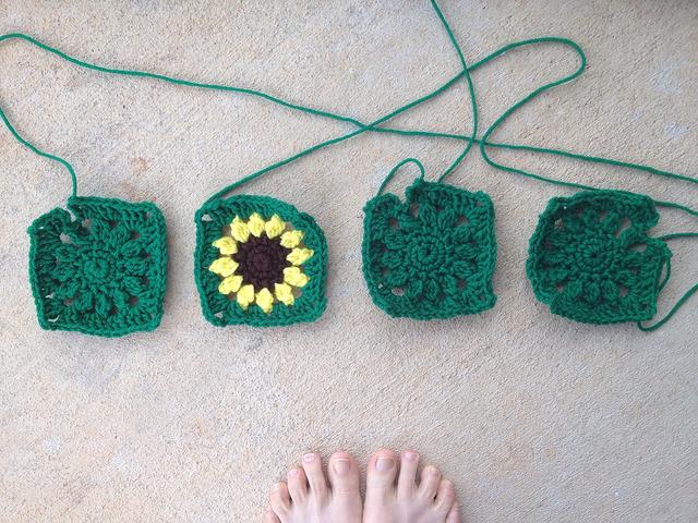 four sunflower crochet squares