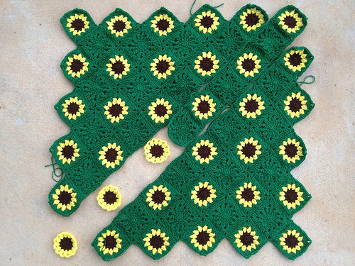 a sarcoma awareness crochet blanket in need of five more sunflower crochet squares