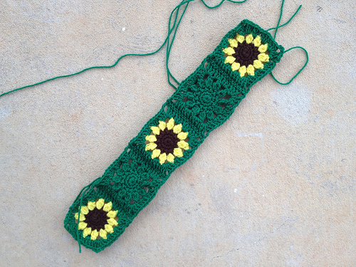 a strip of five sunflower crochet squares for a sarcoma awareness crochet blanket