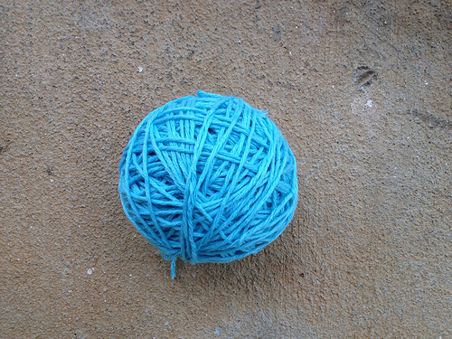 a ball of blue cotton yarn