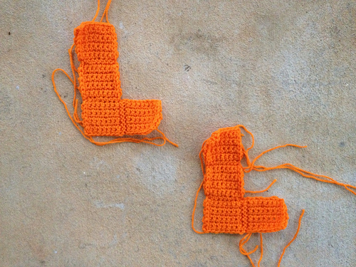 I finish two orange crochet tetrominos