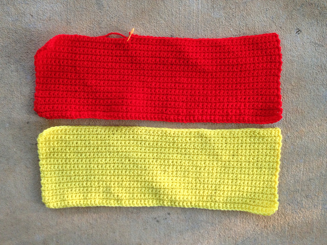 red and yellow crochet rectangles for a crochet blanket for project linus