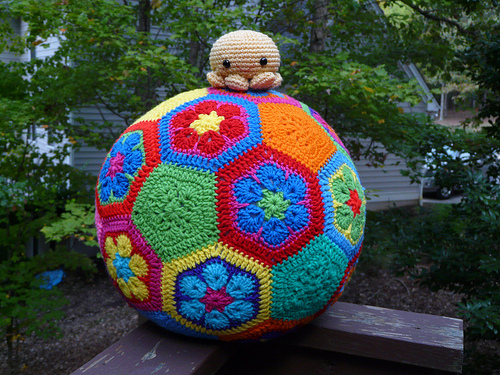 A crochet octopus sitting atop a crochet soccer ball