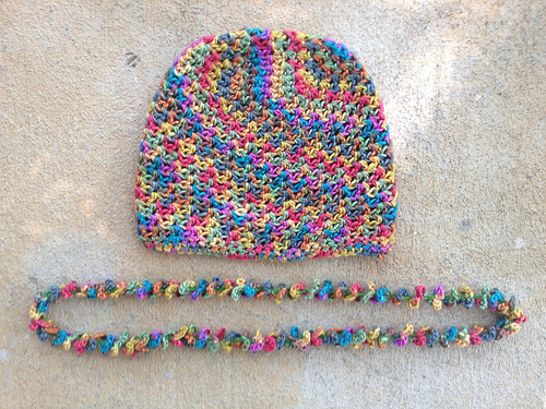 silk crochet chemo cap with a matching crochet lei