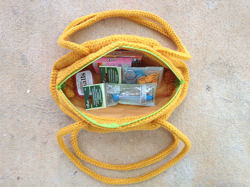 A taco purse with some of the bare necessities