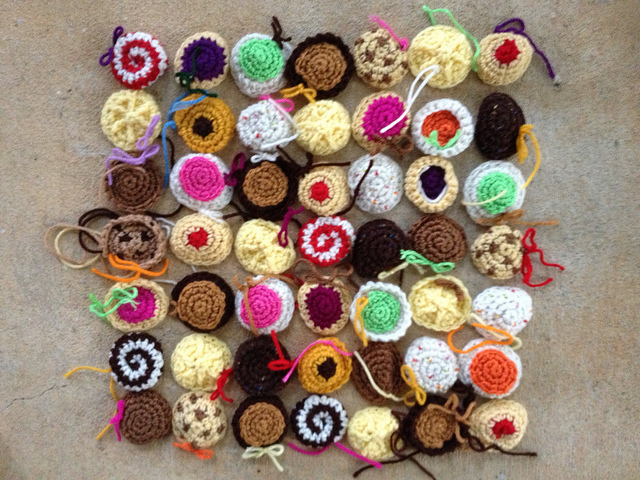 forty-nine small crochet cookies