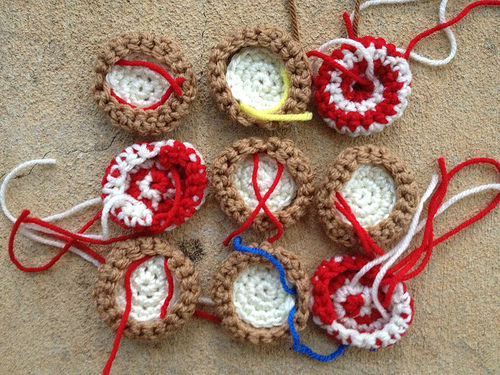 A nine-patch of small crochet cookies