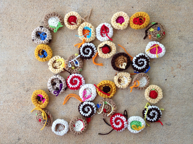 thirty-two small crochet cookies