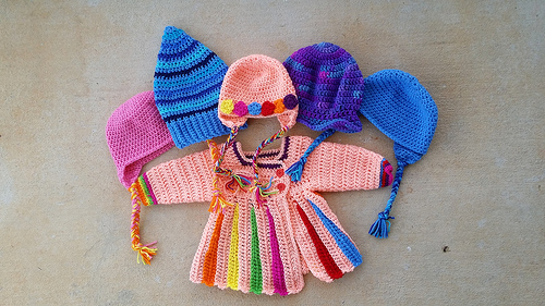 An Eloise crochet sweater and five crochet hats, crochetbug, crochet beanies, crochet flowers, stash buster