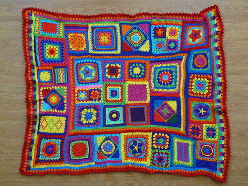 a granny square blanket with crochet stripes to fill in gaps