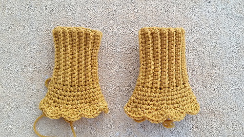 Two curry-colored Victorian texting gloves to be on a lazy day in December