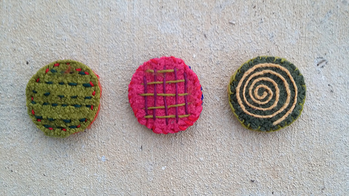 three felted crochet table coasters