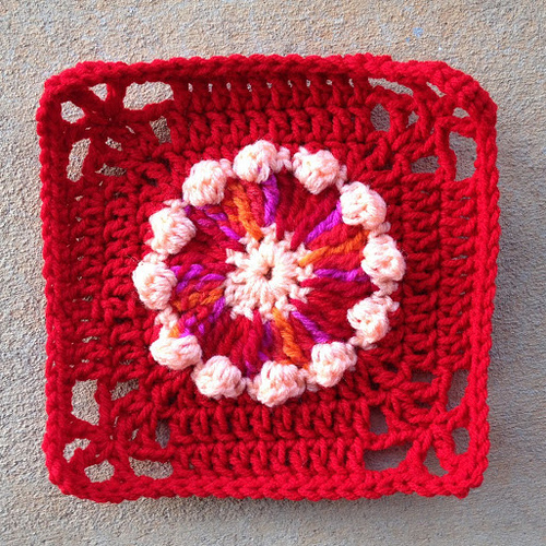 Crochet granny square with a circle at the center