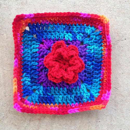Crochet square with appliqué crochet flower